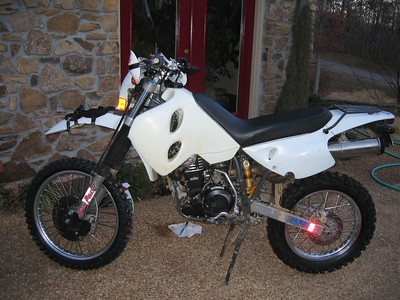 I spent a few days readying this fire breather of a bike for the BAR 2007 trip. The day before I left, a needle bearing in the clutch fragged, and I had to take the bone stock LC4E