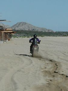 Ron works on his sand riding technique. He fell off 10 seconds later and some locals died laughing!
