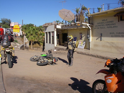 """Regrouping in Mulege, DFWrider falls victim to the gravity monkey.  Bruce looks on with his best, """"WTF?"""""""
