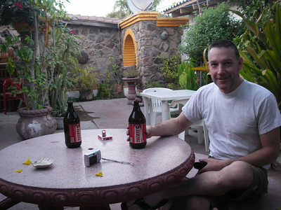 Kicking back at Las Casitas in Mulege, enjoying cold Tecate Caguamas outside our room.  They let us bring the bikes right into their beautiful courtyard.  Nice place, great hospitality.