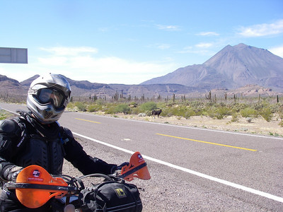 On the way to Sta Rosalita, Estevan poses in front of the Three Virgins Volcano.