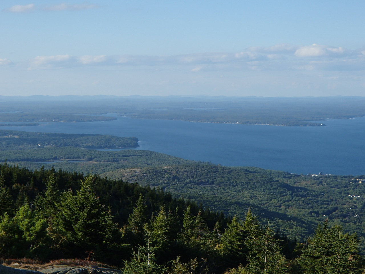 Besides lovely scenery, Cadillac Mountain is famous for its mid-September Hawk migrations.<br /> <br /> How many hawks can you count in this picture?