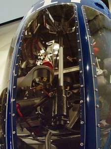 A view through the front window, past the speedo and long steering column.