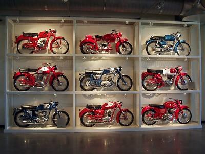 A wall full of Italian singles.... Aermacchis, Ducatis, Parillas, and Moto Guzzis.