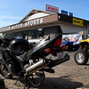 Marv's bike getting a new tire in Colville - photo by Steve