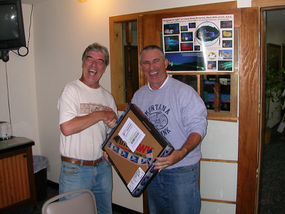 "Aug 28, 8:48 am During the banquet -ah hem, OK Eggo waffles that need to go through the toaster twice,  Keith (left) gets the door prize for longest distance travelled.  Of course, he had to buy it and ship it to the Hotel himself.... ""this isn't WeSTOC, is it?""  Keith is from the UK and had travelled over 9,000 miles in the USA in the course of his 'round the worl tour on his 1300 Pan European and Trans Alp  Go: http://keithooper.smugmug.com/Travel"
