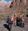 Pete holding two bikes up in Zion