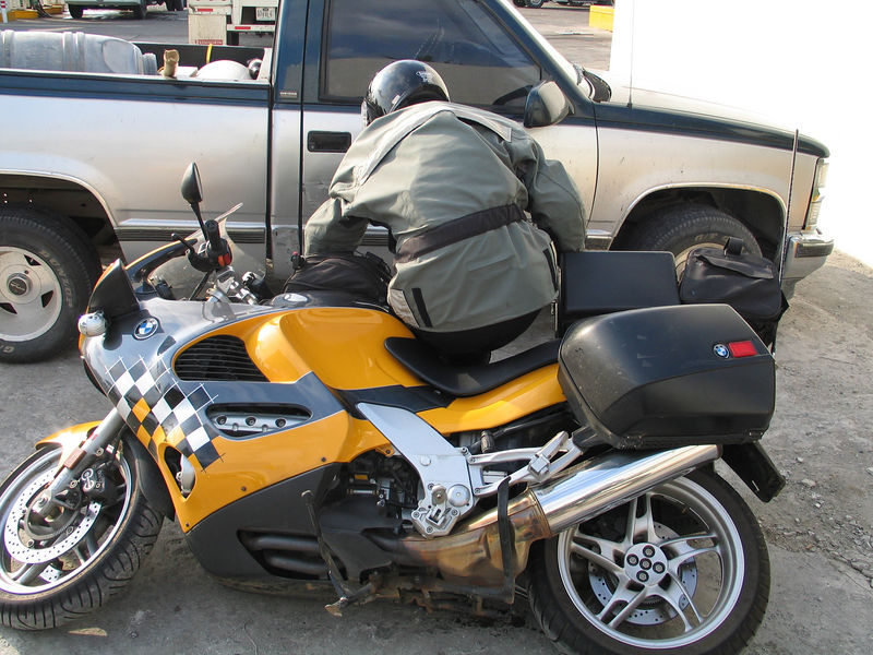 Jackhole drops his bike.  Again.