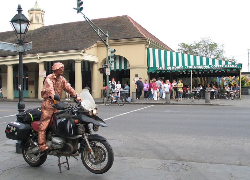 I got the painted guy to pose for this in front of Cafe Du Monde in New Orleans.  No cars!