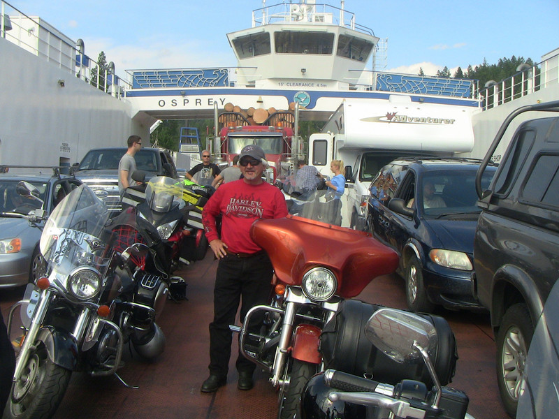 Cliff Kunnary with his copper Harley on the Kootenay Lake Ferry