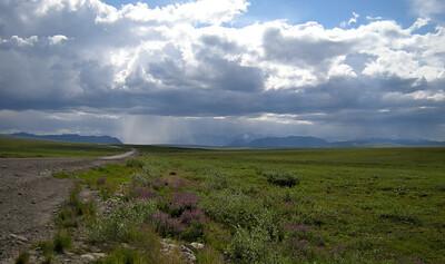 Headed south through the Brooks Range.......that's rain ahead!
