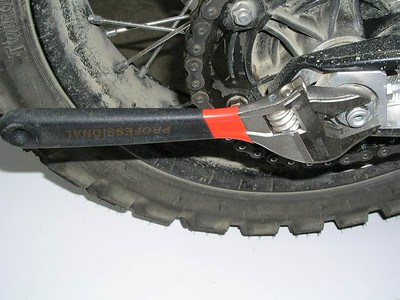 Large crescent wrench on the rear axle nut