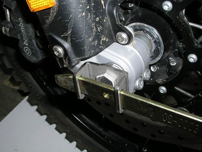 Using the 19mm BestHex to loosen the axle, the 19mm aluminum bar is inside the axle and transfers rotational movement to the axle.    (be sure to loosen axle pinch bolts first)