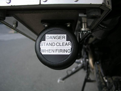 Under pannier storage containers - label keeps the curious away