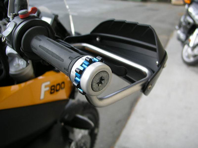 Wunderlich throttle control - the black nubs were added because the Wunderlich blue ring design leaves MUCH to be desired.  The nubs let me make adjustments without cutting my hand on the sharp edges of the blue ring