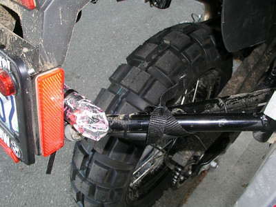Rear knobby, road flare, spare fuel line