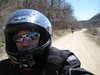Chad on his V-Strom. That's me in the background on my KLR. April 2008 on the gravel roads in Iowa.