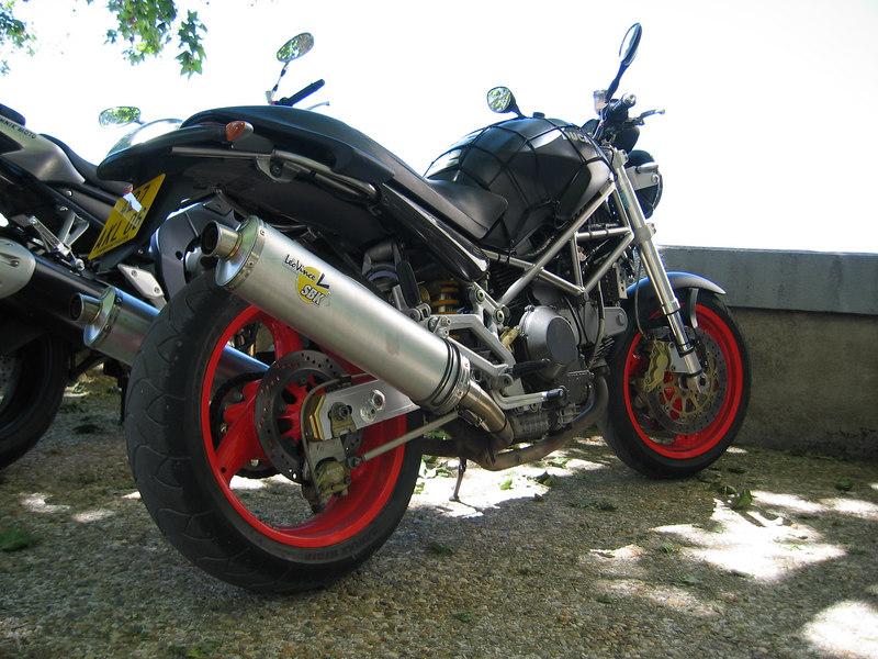 Ducati Monster 900 ie + black + red wheels + Leovinci = wild Italian beauty.
