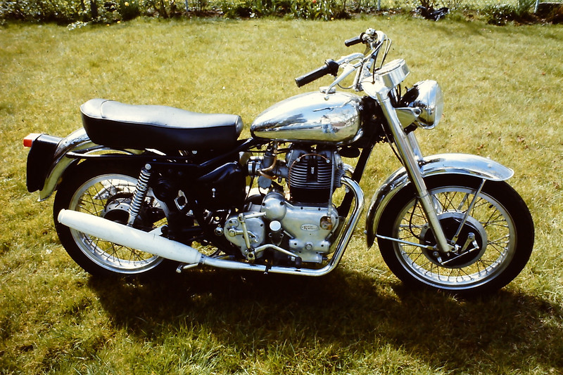 Same bike next spring. Upgrades included newer straight pipes, BSA double leading shoe brake, alloy rims, BSA 12 volt electrics, air filters, lots of chrome. Experiments with the muffler proved a need for something other than white. This model had many unusual features, including mirror image Amal Monobloc carbs (for narrower fitment) neutral finder lever, split cylinders & heads for better cooling & maintenance, beautiful polished cast alloy instrument cluster, cam style chain adjuster, aluminum centrestand, etc