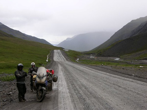 Dale and Dave stop to gear up for the wet weather along the Haul Road, returning from Prudhoe Bay, AK