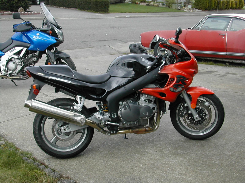 A couple of resurrected bike projects. 2000/2001 Triumph Sprint RS with the '04 650 V-Strom in the background. Taken in 2004