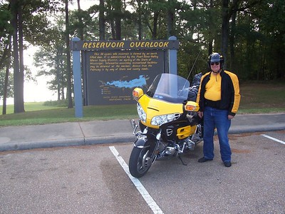 Dad likes to pose in front of signs.   Now that he's 60, I suppose it helps him remember where he was  ;-)