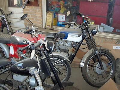 Triumph, Honda 305, and a Mustang....