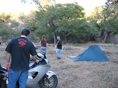 Trip setting up, and an admirer of his Triumph triple.