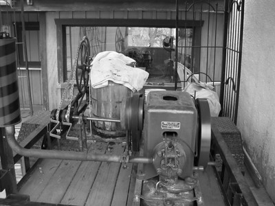 Ice cream machine... a 300 rpm antique engine powers it!   Chuka... chucka... chuka... chuka  Notice the exposed valve train bottom right. And the barber pole muffler.