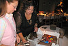 Caroline and Sonia cutting the cake