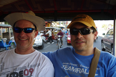 Riding around Phnom Pehn in a tuk tuk.