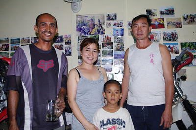 "Bike shop owner Pilot,wife and kid. Khmer guide ""Teng""."