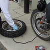 """Connect the """"Donor Hose"""" to the over-inflated (50psi) tire on the bike with the valve core removed on the tire being seated.  In one swift action the donor tire dumps ample pressure into the new tire with a loud """"KER-POP"""" as the bead seats.  Slick."""