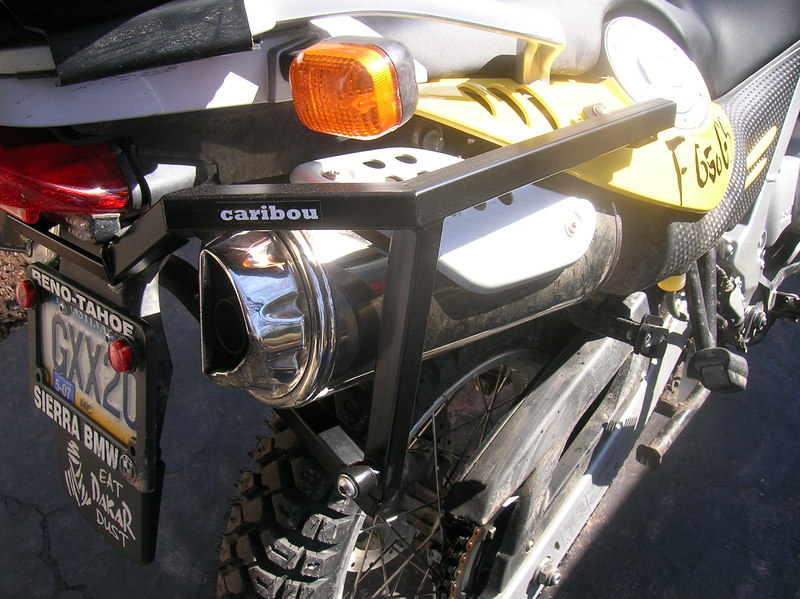 Rear mounting bracket is attached to the frame at the side panel and below the tail light