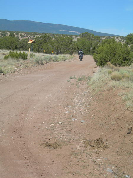 We covered 90 miles, bouncing around between pueblos, only maybe 15 on paved roads. The trip took about four hours.<br /> <br /> What is this very slow-moving speck in the distance...?
