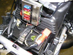 Photo shows Centec panel mounted on my BMW R1200GS.  Location is on the rear of the air box, just above the battery.