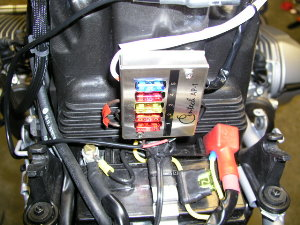 Photo shows Centec panel mounted on my BMW R1200GS.  Location is on the rear of the air box, just above the battery.  White wire leads to accessory lighting.