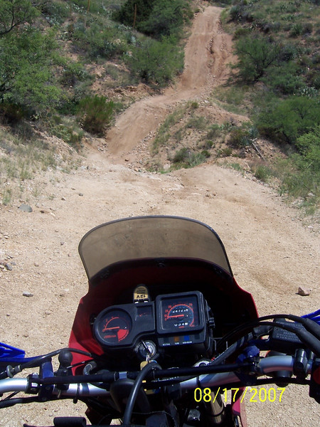 Here is the same location as the previous photo after one year and two monsoon seasons. Many more ruts.