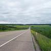 Road with farm fields around