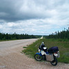 KLR 650, and highway with trees on both sides