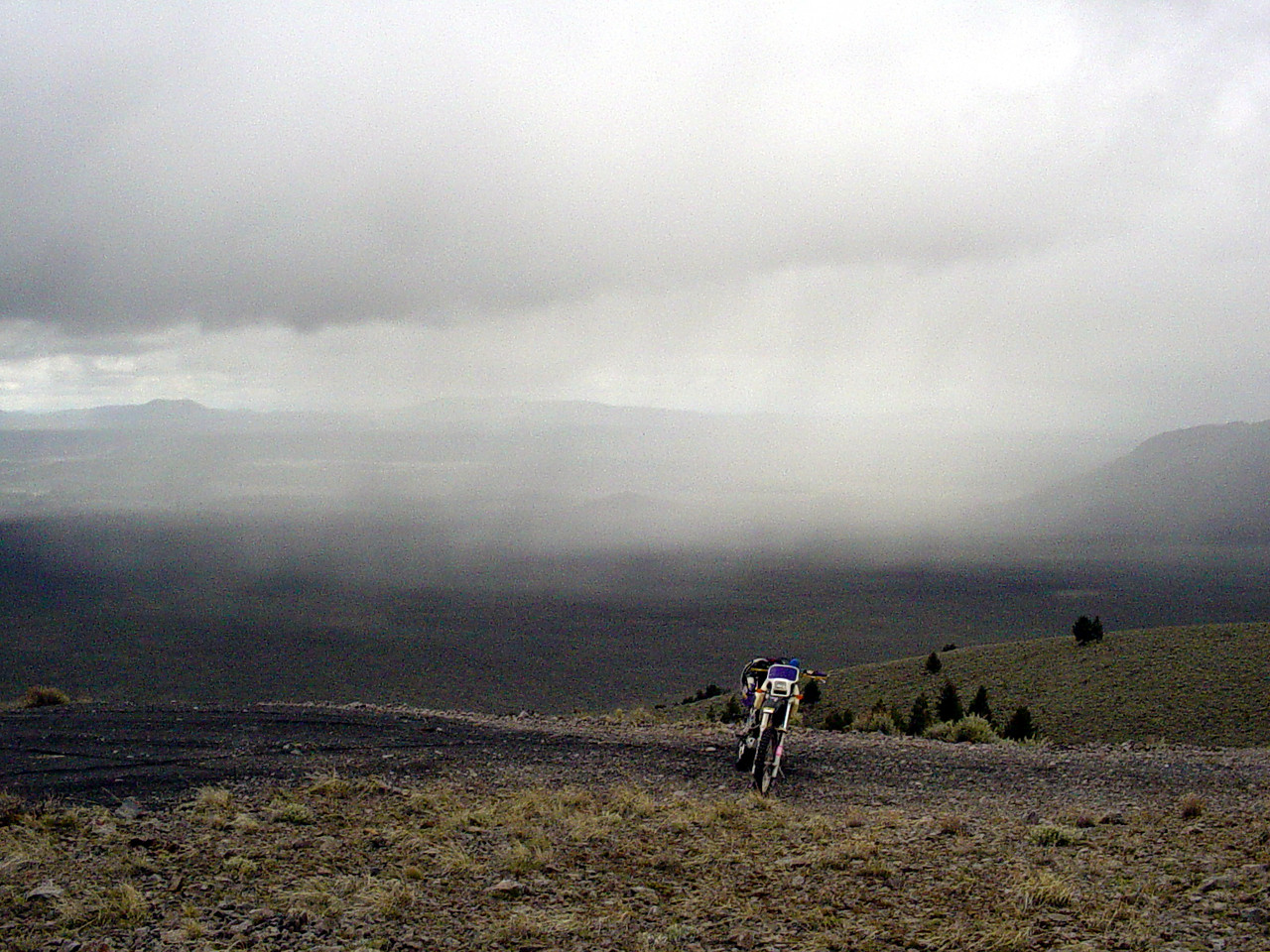 "<font size=""+1"">A view of the rain.  Looking west over the East Fort Rock Riding area... </font>"