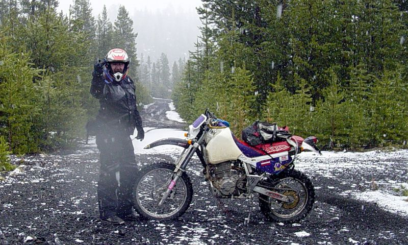 "<font size=""+1"">Yes, I've put the gallery as part ot the <A href=""http://www.advrider.com/"" target=""_blank"">Adventure Rider</A> community.  They have this thing about the Adventure Rider Salute, and so, here I am on this Dual Sport thing where we're at greater than 5000 feet, it's raining, then it's snowing, and there's no end in sight, it just seemed that NOW was the time for The Salute. <P> <font size=""+1"">Oh, so yah, it's cold, it's raining, but do I care?  Not in my new <A href=""http://www.mooseoffroad.com/index_HTML.jsp?link=4&catinfo=yes&a=products&action=Q&product_group_id=2665&category_title=Monarch%20Pass&category_id=803&parent_id=768&parent_title=Outerwears&product_name=MONARCH%20PASS%20JACKET&group=Outerwears"" target=""_blank"">Moose Racing</a> ""Monarch Pass"" riding gear.  I added no layers to the basic pants, jersey, jacket and gloves and was tolerably warm the entire time.  I did take extra dry gloves with me, and that turned out to be a VERY good thing after about 60 miles of this.  ;-)  <P> <font size=""+1"">I passed a TON of chattering losers huddled over their exhaust headers trying to restore sensation to their fingers..  Look!  Mine still work fine!  ;-) </font>"