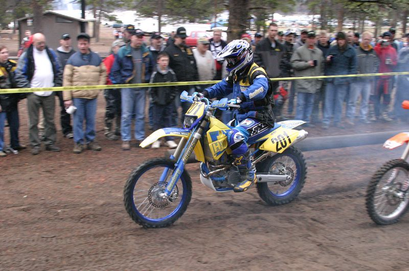 "<font size=""+1"">The following day, the ISDE kicks off.  Here's Rick Bozarth, first rider out of the gate, taking off..  Pretty well prepared rig he's riding on..  Lust, lust... </font>"