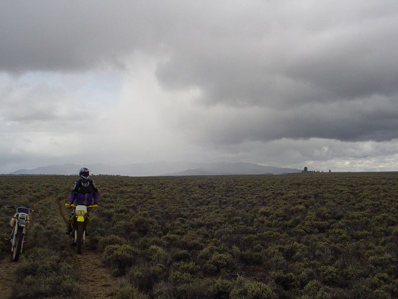 "<font size=""+1"">Later, quite a ways south, looking back north where you can see Pine Mountain.  Well sort of.  It's behind that wall of rain/snow that we rode AROUND to get where we're at.. </font>"