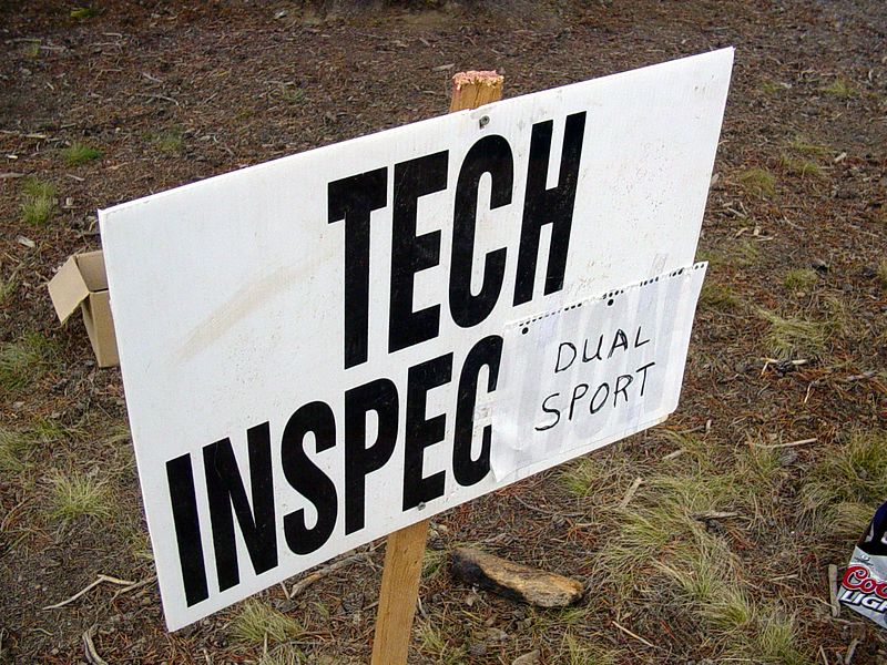 "<font size=""+1"">Upon returning to the start/finish point, we were surprised to see a ""Tech Inspection"" sign, where, of all things, we were checked for all the ""street legal"" amenities, FOR POINTS no less..  First we picked yet MORE cards, this time sans any face cards, where I got a sting of eights and nines - still on a roll! <P> <font size=""+1"">So, flush with my success with cards and BB's, and having turned in my two cheese burger receipts, I head over to the Tech Inspection, where I lose points for not having a DOT high/low beam head light and (there's more about this later) for not having my drivers license with me.  For a wonder, everything else on my bike is working for a change, turn signals, horn, tail and brake light, but when he asks for my drivers license and insurance forms...  SIgh.. I get the insurance papers out (I keep them on the motorcycle itself) then turn to him and say, I don't have my drivers license with me, because I don't ""think"" that I do.  Woops, between the high/low beam and my drivers license, I'm dinged 10 points for a total score of 148.  That's just 3 points under the current highscore!  Hey, not bad.. </font>"