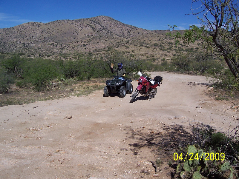 Gordon came home for a brief period after winter semester and prior to the spring term. We decided to rent a quad and go riding to Chiva Falls in the Redington Pass area. This Gordon and my motorcycle.