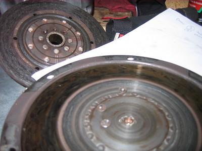 Three rivet heads were bouncing around between the friction disc hub and the pressure plate. In the background seriously ovalled holes in the clutch spline hub. ANyone else seen this failure mode or is it just one more case of Jesse being unique????