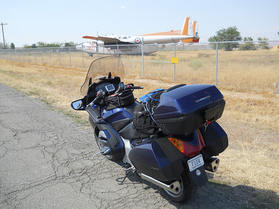 Rick's bike in front of a 119... he actually flew one of these I think I remember him saying.  I miss my friend. Notice the F104 plate... he did fly those
