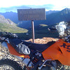 In the saddle just left of the signpost, the way to Telluride.