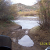I passed several other No Tresspassing signs on the way to the river. Every little cowtrail leading to the RR tracks had a sign by it. I was getting the feeling that someone didn't want me there. The river was running much deeper than before when we had crossed. I was not about to try.